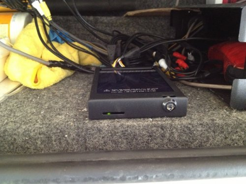 in vehicle video surveillance recorder mounted in accessory shelf
